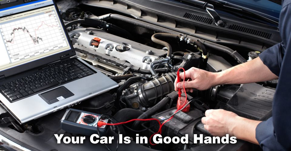 Your Car Is in Good Hands | Male mechanics working in auto repair service