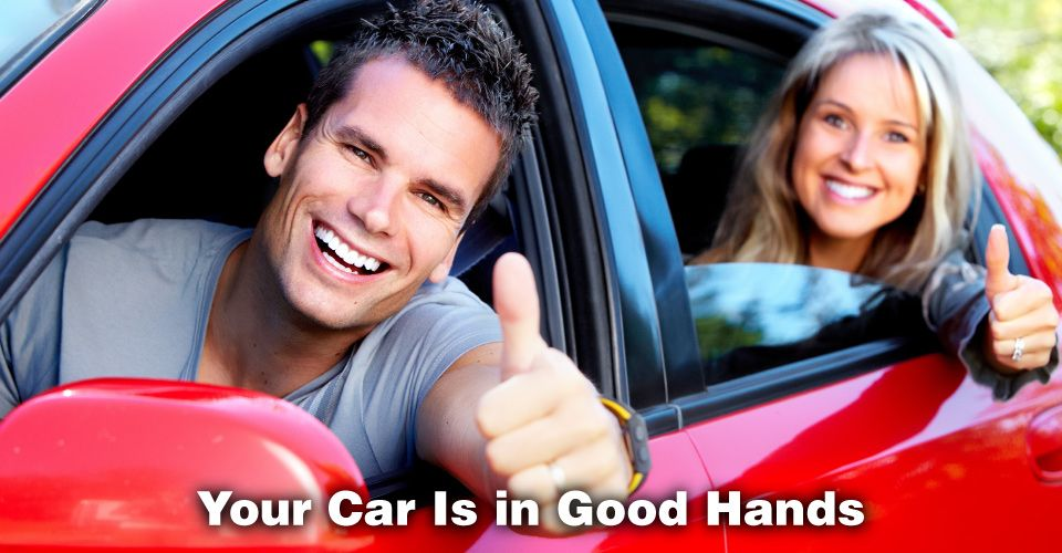 Your Car Is in Good Hands | Happy couple in a red car