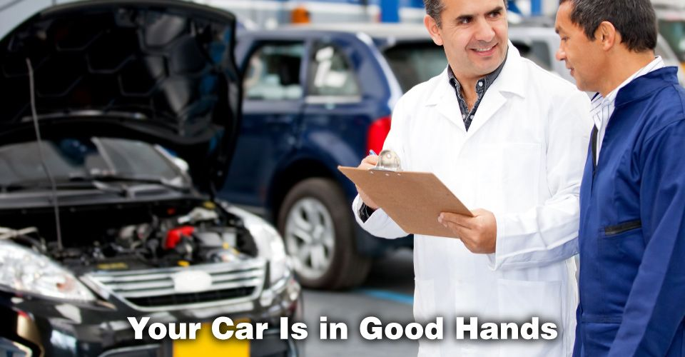 Your Car Is in Good Hands | Male mechanics talking at a car garage